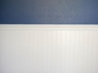 Blue-wall-with-white-paneling-