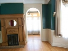 Interior-(-teal-room-w-doorway-and-fireplace