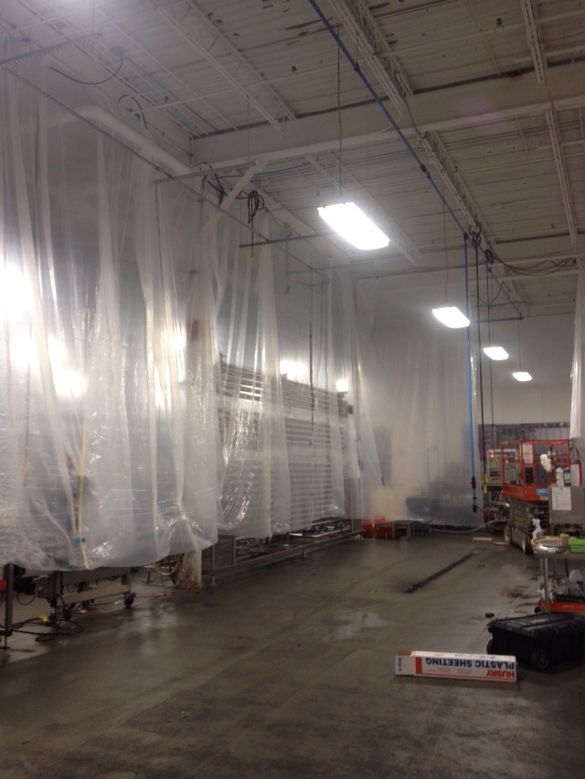 Specially seal off areas to be sprayed with dry fall paint in a commercial food manufacturer in Missouri